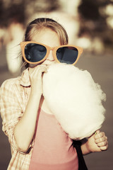 School girl eating cotton candy