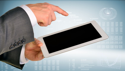Businessman hand using tablet computer
