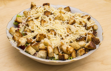 Salad with croutons, chicken, cheese and greens