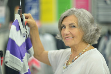 Smiling old lady in store