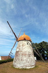 Red windmill in azores island