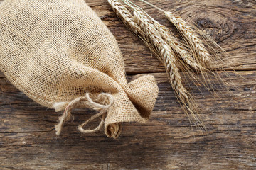 rye with a linen bag on wooden background
