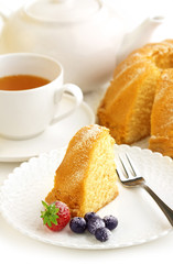 portion of cake and cup of tea