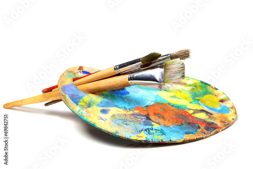 Leinwanddruck Bild Art palette with paint and a brush on white background