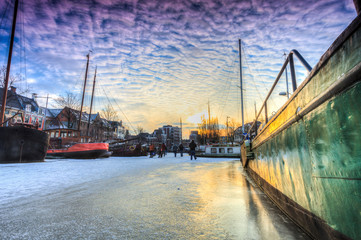 Winter landscape of a  canal in a city