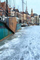 Ship in a canal in a city in winter