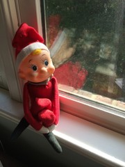 Retro elf doll on window ledge