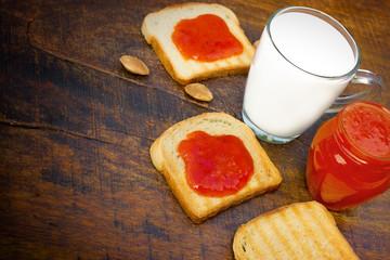 Apricot jam on toast on table