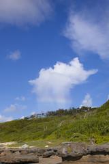 沖縄の夏の雲と空と虹
