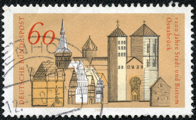 stamp printed in Germany, shows old city