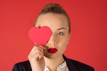 business woman holding a heart