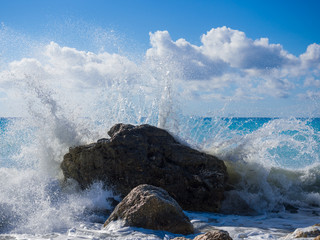 waves breaking on a stony beach