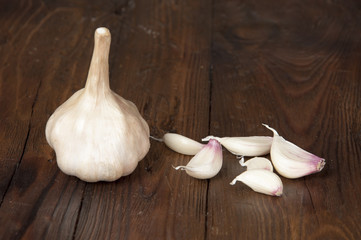 garlic on old wooden table