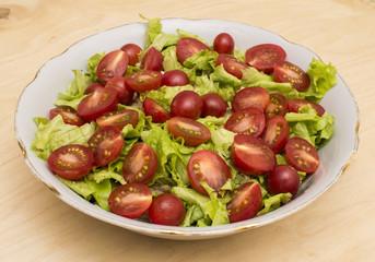 Tomatoes on lettuce leaves