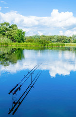 summer fishing on the river with fishing rods