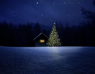 Schihütte mit Christbaum bei Nacht