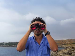 boy with binoculars scanned the horizon