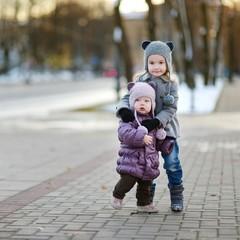 Two sisters having fun at winter city