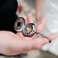 A man holding an antique pocketwatch