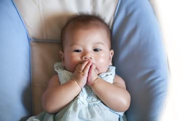 Infant baby girl face looks away