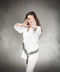 karate girl concentration before hit