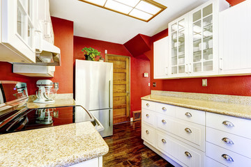 White kitchen room with contrast bright red walls