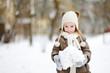 Adorable little girl having fun on winter day