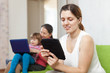 women and child with electronic devices