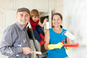 Happy family of three makes repairs
