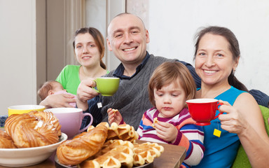 Portrait of  happy family having tea