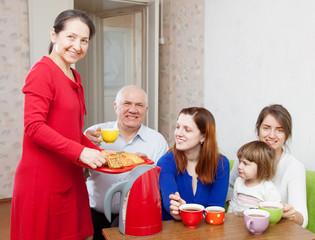 multigeneration family having breakfast