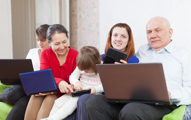 family of with computers  at home