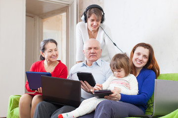 Happy family of with various  computers