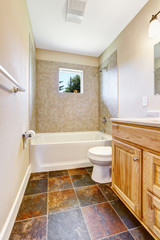 Empty bathroom with tile wall trim and window