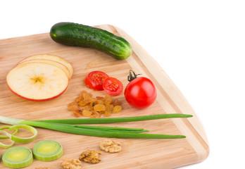Close up of vegetables on wooden platter.