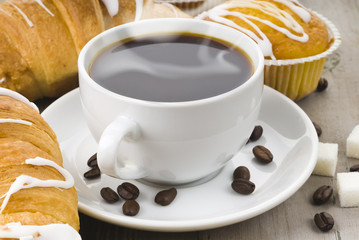 cup of hot coffee with muffin