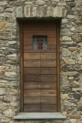 Barn door of wood secured with padlock