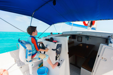 Boy drives catamaran
