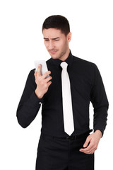 Young Businessman Looking Surprised at His Smart Phone