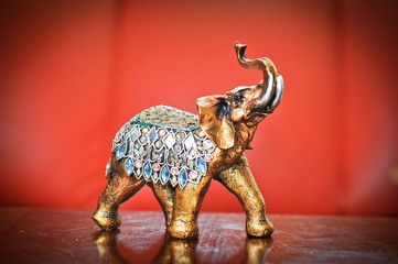 Golden indian elephant on table. Decorative elephant statue