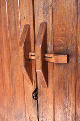 Door handle on brown wood door