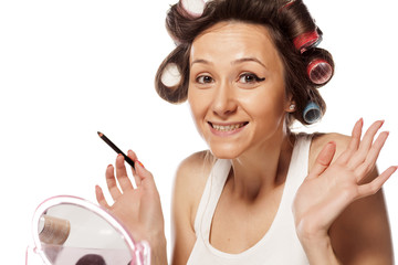 partly made up satisfied housewife with curlers