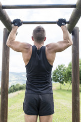 Athletic man exercising and training, outdoor.