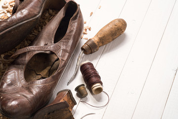 Old shoes and recovery tools. Background