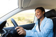 young african woman driving a car - 69855988