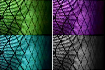 Wire fence at tennis court. Colored backgrounds