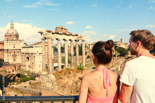 Rome tourists looking at Roman Forum landmark