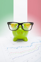 Piggy bank with flag on background - Italy
