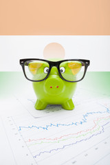 Piggy bank with flag on background - Niger