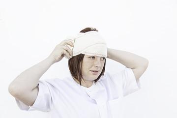 Girl bandaged head